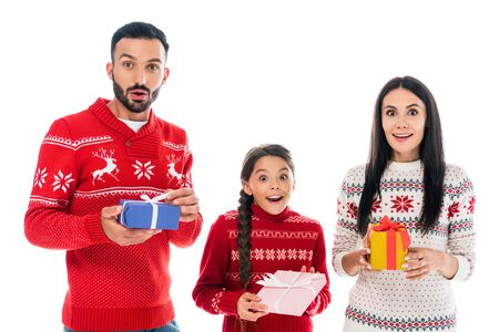 excited family in sweaters holding presents isolated on white