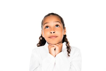 adorable african american schoolgirl looking up and showing please gesture isolated on white Reklamní fotografie