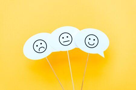 set of emoticons on speech bubbles and sticks on orange