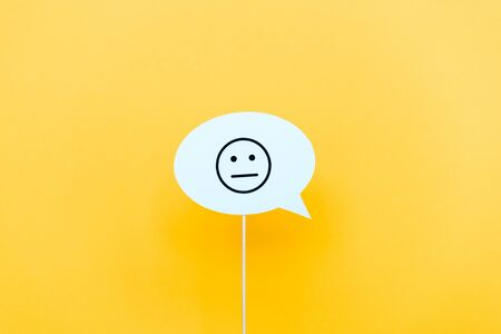 upset face on speech bubble on orange Stockfoto