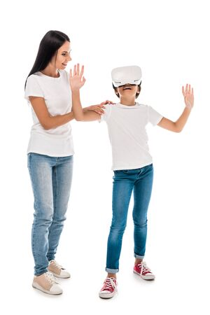 mother standing with kid in virtual reality headset isolated on white