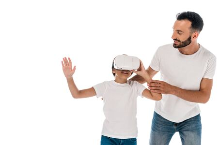 smiling father standing with happy kid in virtual reality headset isolated on white