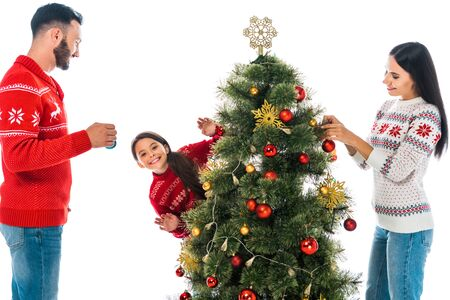 happy family decorating christmas tree isolated on white 免版税图像