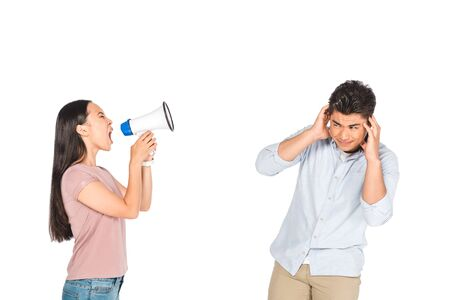 angry asian girl screaming into megaphone at boyfriend covering ears with hands isolated on white