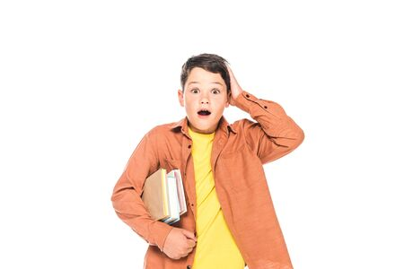 front view of shocked kid holding books isolated on white