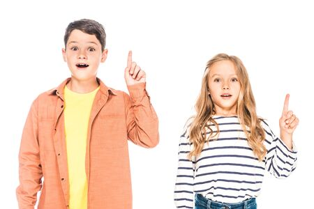 front view of two surprised kids showing idea signs isolated on white