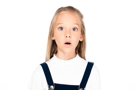 cute, shocked schoolgirl looking at camera isolated on white