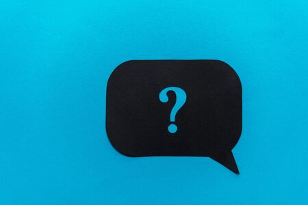 top view of of black question mark on speech bubble isolated on blue Stockfoto