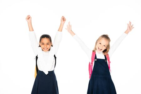 two happy multicultural schoolgirls showing yes gestures isolated on white 写真素材 - 131880833