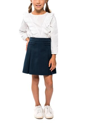 cropped view of school kid standing with hand on hip isolated on white