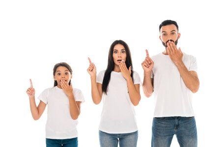 surprised parents and kid covering faces and pointing with fingers isolated on white