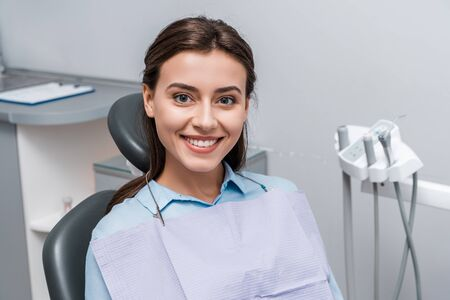 beautiful woman sitting and smiling in dental clinic