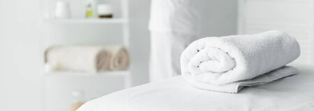 panoramic shot of white towel on massage mat in spa Фото со стока - 131846959