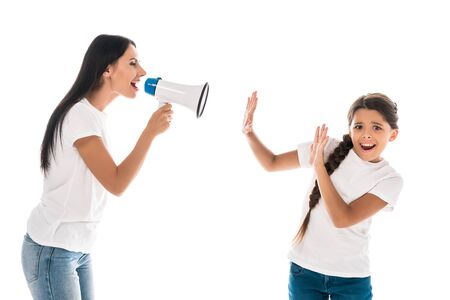 woman holding megaphone while yelling near kid isolated on white