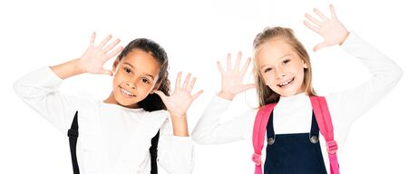 panoramic shot of two cheerful multicultural schoolgirls showing chalk stained hands  isolated on white 写真素材 - 131880108
