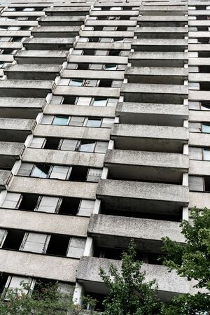 low angle view of building with windows near trees in chernobyl