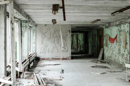 abandoned and creepy classroom with dirty walls in school 写真素材