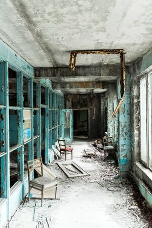 abandoned and dirty room with chairs in school