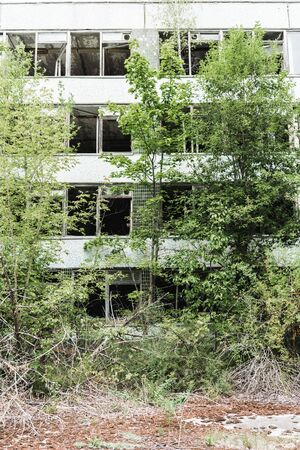 abandoned building near green trees in chernobyl