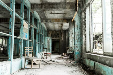 abandoned room with dirty chairs in school Banco de Imagens