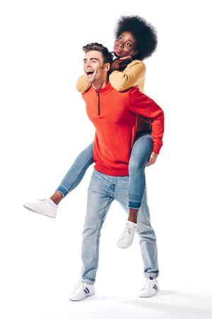 happy boyfriend piggybacking his african american girlfriend, isolated on white Stok Fotoğraf