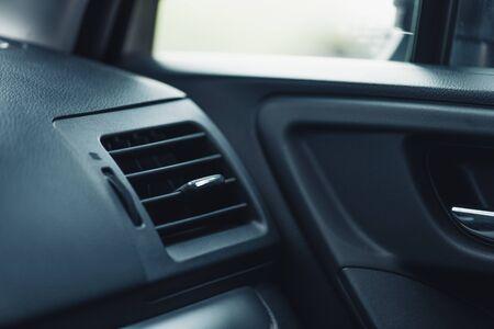 adjustable ventilation grille on dashboard of modern car