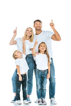 happy family looking up and pointing with fingers on white