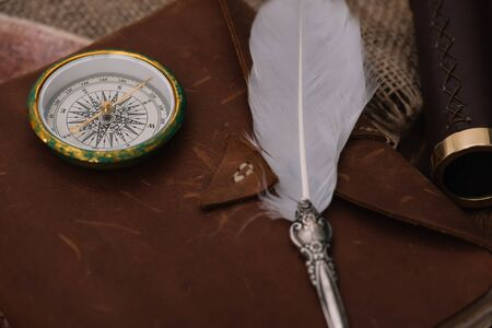 nib and compass on leather copy book on hessian