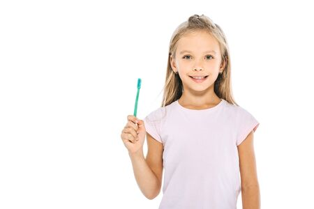 cheerful kid holding toothbrush isolated on white 免版税图像