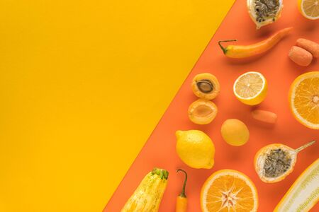 top view of delicious fruits and vegetables on yellow and orange background with copy space Banque d'images
