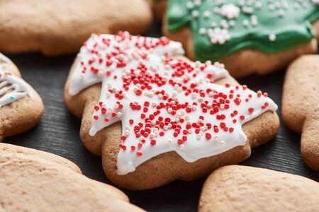 close up view of delicious glazed Christmas tree cookie