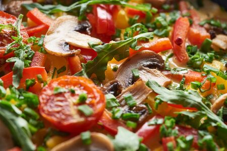 close up of tasty homemade omelet with mushrooms, tomatoes and greens Banco de Imagens