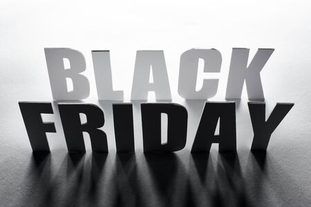 top view of black Friday lettering with shadow on white background Stock Photo
