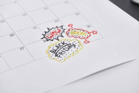 selective focus of calendar with lettering black friday, wow, boom