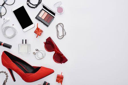 top view of gadget, gift boxes, perfume, bracelets, decorative cosmetics, earrings, earphones, shoes