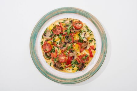 top view of plate with tasty omelet for breakfast on white table Banco de Imagens