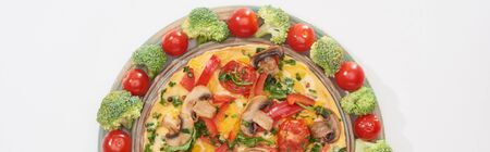 top view of yummy omelet on plate with fresh tomatoes and broccoli