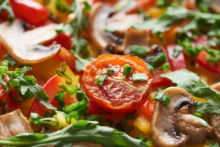 close up of delicious omelet with vegetables and greens