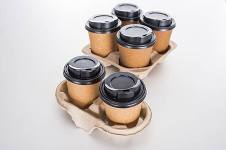 paper cups with coffee in cardboard tray on white background 写真素材