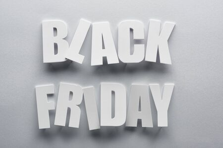 top view of black Friday lettering on grey background