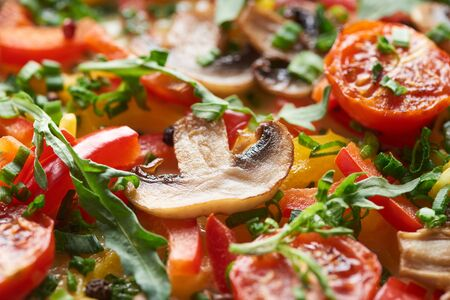 close up of delicious omelet with mushrooms, tomatoes and greens