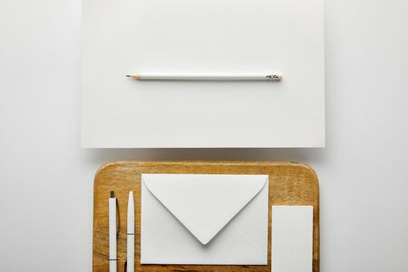 top view of envelope, business card and pens on wooden board, pencil, paper Stok Fotoğraf