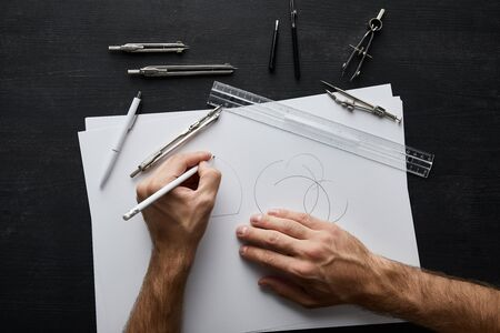 cropped view of architect drawing circle on white paper with pencil Stok Fotoğraf