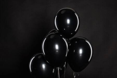 bunch of black balloons isolated on balck, black Friday concept