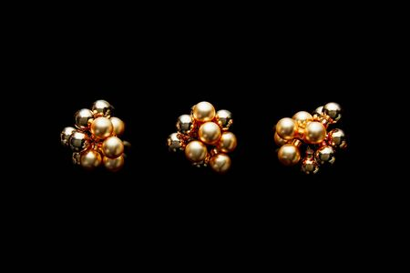 top view of shiny golden Christmas decoration isolated on black Stock Photo