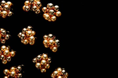 top view of shiny golden Christmas decoration isolated on black with copy space