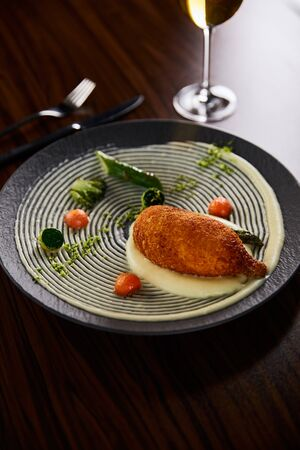 delicious chicken kiev and mashed potato served on plate on wooden table