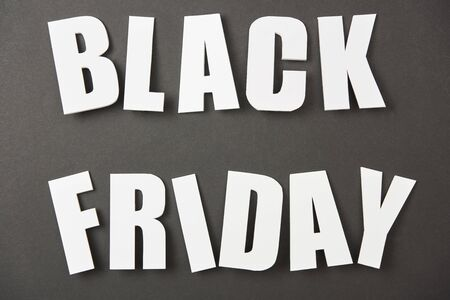 top view of black friday white lettering on black background