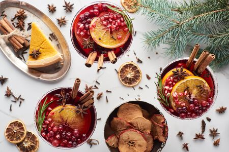 top view of christmas cocktails with orange, pomegranate, cinnamon, dry apples and pie Stok Fotoğraf