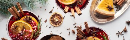 panoramic shot of christmas cocktails with orange, pomegranate, cinnamon and pie on tray Stok Fotoğraf
